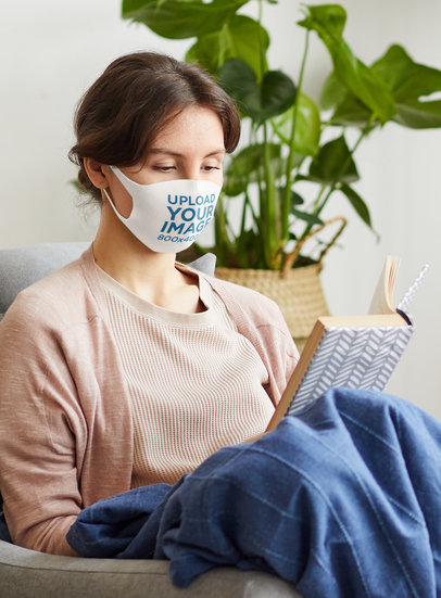 Mockup of a Woman Wearing a Face Mask While Reading at Home M3722-r-el2
