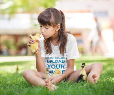 T-Shirt Mockup Featuring a Girl Playing with Ducklings 42895-r-el2