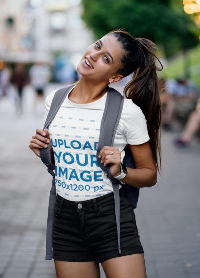 T-Shirt Mockup of a Joyful Student on the Street 45023-r-el2