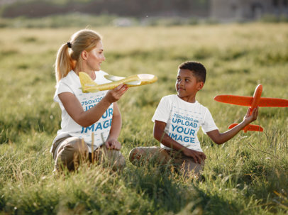 T-Shirt Mockup of a Kid and a Woman Playing With Airplane Toys 44465-r-el2