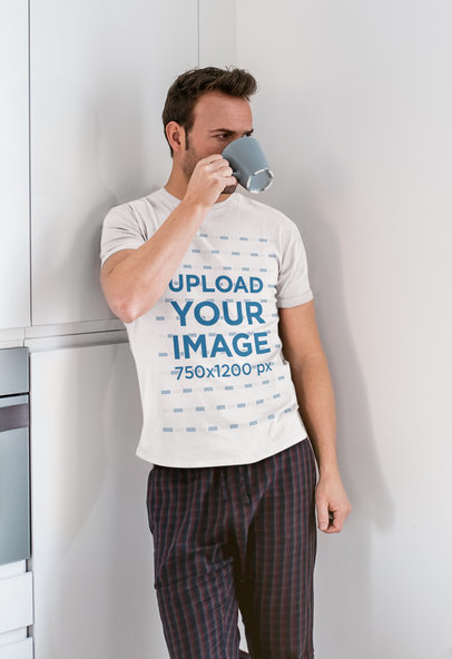 T-Shirt Mockup of a Man Drinking Coffee in His Kitchen 40152-r-el2