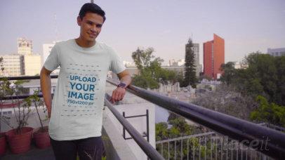 T-Shirt Mockup of a Man Posing at a Balcony 3105v