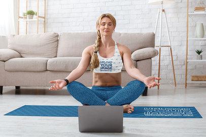 Sports Bra and Yoga Mat Mockup Featuring a Woman Meditating at Home m6766-r-el2