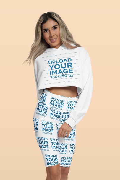 Activewear Mockup of a Woman Wearing Leggings and a Crop Top Hoodie 42359a