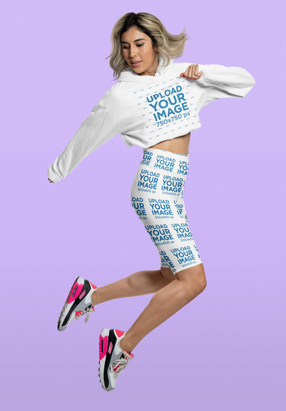 Crop Top Hoodie and Biker Shorts Mockup of a Woman Jumping 42362a