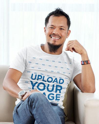 T-Shirt Mockup Featuring a Bearded Man Sitting on a Sofa 39467-r-el2