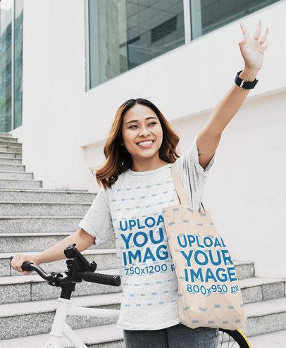 Unisex T-Shirt Mockup of a Woman Carrying a Tote Bag 46901-r-el2