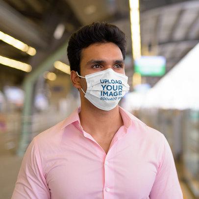 Mockup of a Man Wearing a Face Mask and a Pink Shirt 42186-r-el2