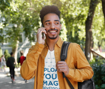 T-Shirt Mockup of a Young Man on The Phone While on His Way to School M8255-r-el2