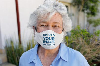 Face Mask Mockup Featuring a Happy Senior Woman 46063-r-el2