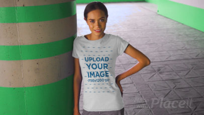 T-Shirt Video of a Happy Young Woman Posing by a Concrete Column 3383v
