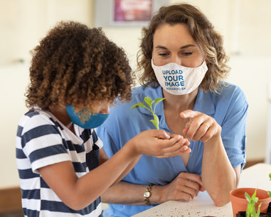 Face Mask Mockup Featuring a Woman Teaching a Kid to Transplant a Small Tree 45448-r-el2
