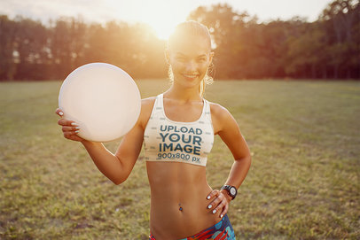 Sports Bra Mockup of a Smiling Young Woman with a Flying Disc M5089-r-el2