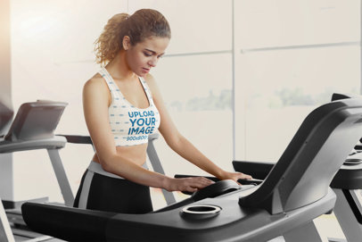 Sports Bra Mockup of a Woman About to Start Running on a Treadmill 38369-r-el2