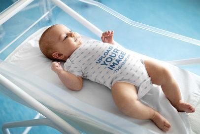 Onesie Mockup of a Happy Baby in a Portable Crib 45749-r-el2