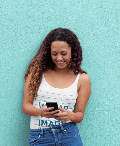 Tank Top Mockup of a Happy Woman Using Her Mobile Phone 38903-r-el2