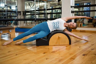 Tank Top Mockup of a Woman Stretching at a Gym 41569-r-el2