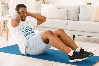 Basic T-Shirt Mockup Featuring a Young Man Exercising at Home 44552-r-el2