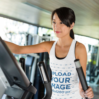 Mockup Featuring a Young Woman Wearing a Heathered Tank Top at the Gym 46879-r-el2