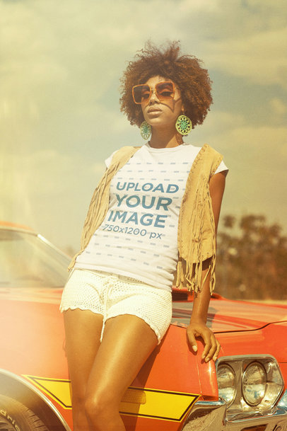 T-Shirt Mockup Featuring a Woman in a 70s Style Outfit Posing by a Car m10498