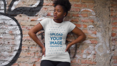 T-Shirt Video Featuring a Serious Woman Posing Against a Brick Wall 3402v