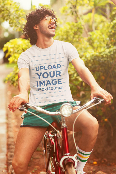 Retro-Themed T-Shirt Mockup Featuring a Happy Man Riding a Bicycle m10125
