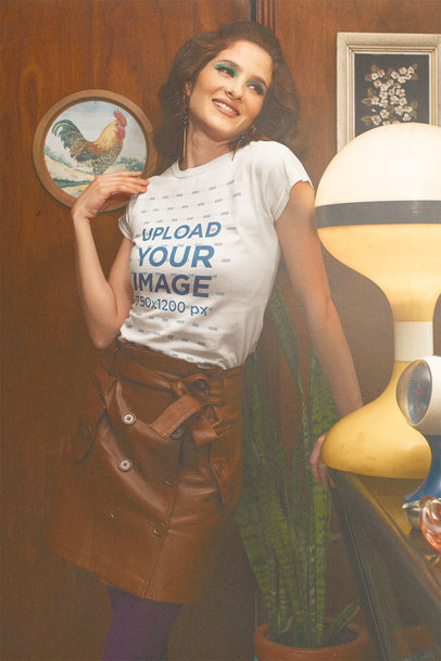 T-Shirt Mockup of a Smiling Woman Posing in a House with Retro Decor m10532