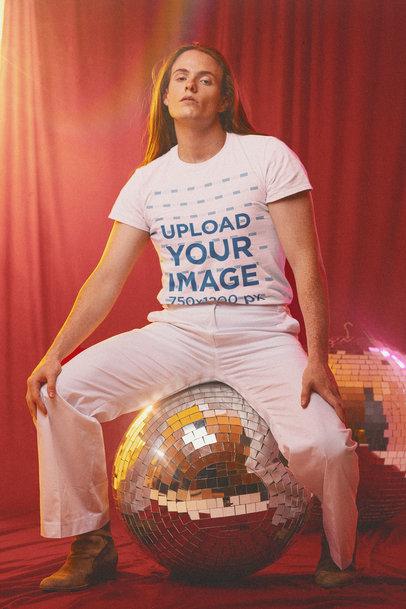 T-Shirt Mockup of a Man Sitting on a Disco Ball m10153