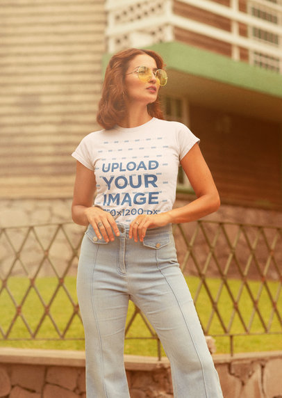 T-Shirt Mockup Featuring a Woman Wearing Retro-Styled Garments m10128