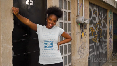 T-Shirt Video of a Happy Woman Posing in an Urban Setting 3403v