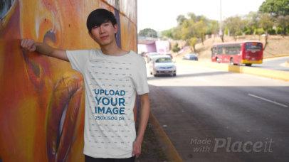 T-Shirt Video Featuring a Man Posing by Street Art 3417v