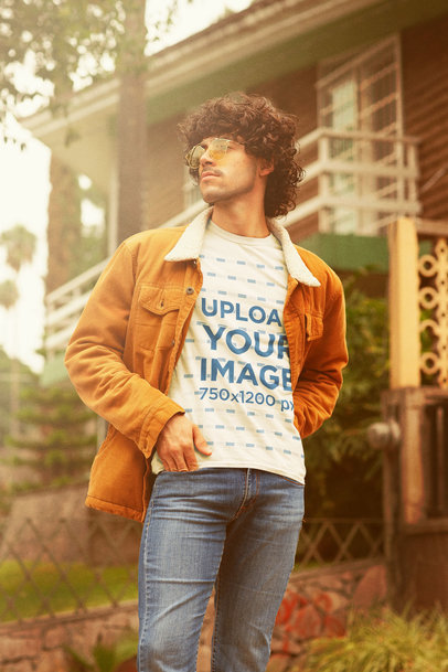 T-Shirt Mockup Featuring a Curly-Haired Man With a Retro Style m10119