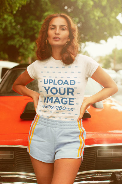 Tee Mockup of a Woman in a 70's Summer Outfit by a Classic Car m10134