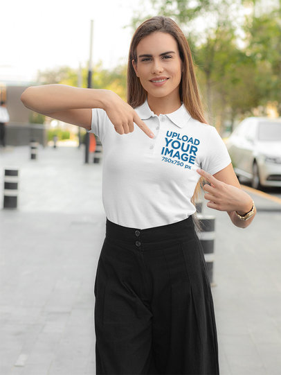 Mockup of a Long-Haired Woman Pointing at Her Polo Shirt 33541a
