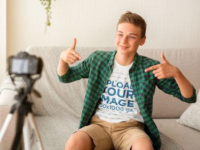 T-Shirt Mockup of a Boy Recording a Vlog 45529-r-el2