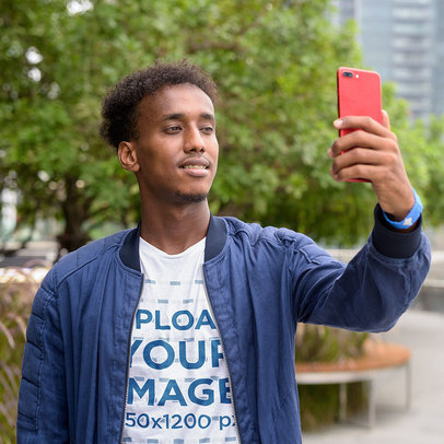 T-Shirt Mockup of a Young Man Taking a Selfie in the City 10086-r-el2