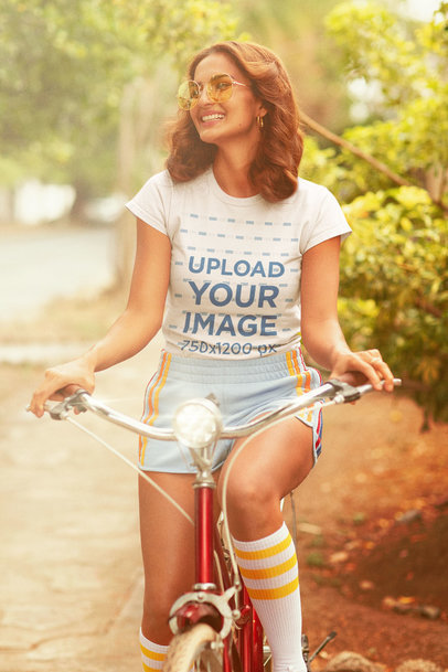 70s-Themed T-Shirt Mockup of a Happy Woman Riding a Bicycle m10137