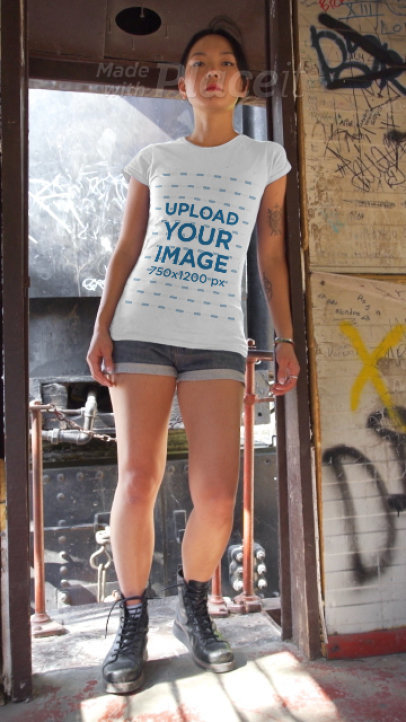 T-Shirt Video of a Woman Posing at an Abandoned Wagon 3427v