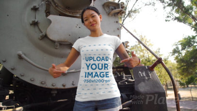 T-Shirt Video Mockup of a Tattooed Woman Posing Next to an Old Locomotive 3425v