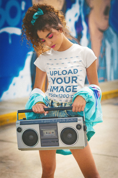 T-Shirt Mockup Featuring a Woman Holding a Retro Boombox m11591