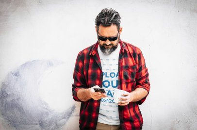 T-Shirt Mockup of a Man With a Flannel Checking His Phone M10382-r-el2