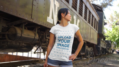 T-Shirt Video Featuring a Young Woman Posing By an Old Train 3422v