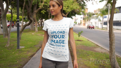 T-Shirt Video of a Confident Woman Walking by a Street with Trees 3472v