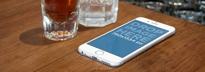White iPhone 6 On Wooden Counter Bar Wide