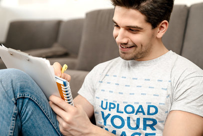 T-Shirt Mockup of a Smiling Man Writing Down Some Notes M11004-r-el2