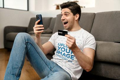 T-Shirt Mockup of a Happy Man Shopping Online M11001-r-el2