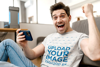 T-Shirt Mockup of a Man Playing Mobile Games M11005-r-el2