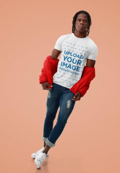 Basic T-Shirt Mockup Featuring a Serious Man Against a Plain Backdrop m10770