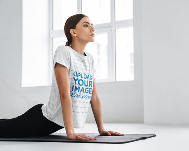 Heathered T-Shirt Mockup Featuring a Long-Haired Woman Doing Yoga M10967-r-el2