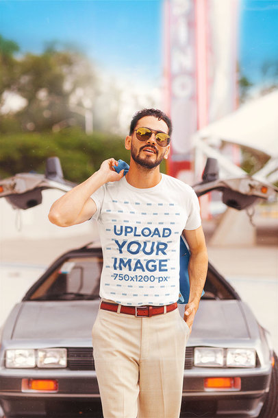 T-Shirt Mockup Featuring a Bearded Man Posing by an 80s Car m12020
